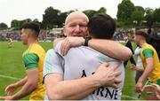 23 June 2019; Donegal Manager Declan Bonner, centre, celebrates  selector Karl Lacey after the Ulster GAA Football Senior Championship Final match between Donegal and Cavan at St Tiernach's Park in Clones, Monaghan. Photo by Oliver McVeigh/Sportsfile