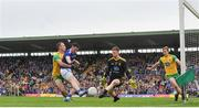 23 June 2019; Conor Rehill of Cavan misses a goal opportunity under pressure from Paddy McGrath, right, and Shaun Patton of Donegal during the Ulster GAA Football Senior Championship Final match between Donegal and Cavan at St Tiernach's Park in Clones, Monaghan. Photo by Sam Barnes/Sportsfile