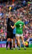 23 June 2019; Conor McGill of Meath is issued with a yellow card by referee Sean Hurson during the Leinster GAA Football Senior Championship Final match between Dublin and Meath at Croke Park in Dublin. Photo by Ray McManus/Sportsfile