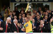 23 June 2019; Michael Murphy of Donegal holds aloft the Anglo Celt cup after the Ulster GAA Football Senior Championship Final match between Donegal and Cavan at St Tiernach's Park in Clones, Monaghan. Photo by Oliver McVeigh/Sportsfile