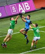 23 June 2019; Conor McGill of Meath punches the ball clear of team-mate Ronan Ryan and Niall Scully of Dublin during the Leinster GAA Football Senior Championship Final match between Dublin and Meath at Croke Park in Dublin. Photo by Brendan Moran/Sportsfile