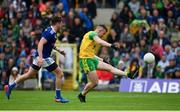 23 June 2019; Patrick McBrearty of Donegal scores a point under pressure from Conor Moynagh of Cavan  during the Ulster GAA Football Senior Championship Final match between Donegal and Cavan at St Tiernach's Park in Clones, Monaghan. Photo by Sam Barnes/Sportsfile