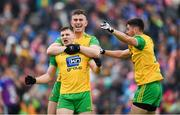 23 June 2019; Jamie Brennan, left, celebrates with Donegal team-mates Patrick McBrearty and Ryan McHugh after scoring his side's first goal during the Ulster GAA Football Senior Championship Final match between Donegal and Cavan at St Tiernach's Park in Clones, Monaghan. Photo by Ramsey Cardy/Sportsfile