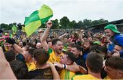 23 June 2019; Ryan McHugh of Donegal celebrates with supporters following the Ulster GAA Football Senior Championship Final match between Donegal and Cavan at St Tiernach's Park in Clones, Monaghan. Photo by Ramsey Cardy/Sportsfile
