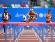 23 June 2019; Sarah Lavin of Ireland, centre, on her way to finishing second in the Women's 100m hurdles during Dynamic New Athletics qualification match three at Dinamo Stadium on Day 3 of the Minsk 2019 2nd European Games in Minsk, Belarus.