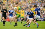 23 June 2019; Paddy McBrearty of Donegal in action against Jason McLoughlin and Conor Moynagh of Cavan during the Ulster GAA Football Senior Championship Final match between Donegal and Cavan at St Tiernach's Park in Clones, Monaghan. Photo by Oliver McVeigh/Sportsfile