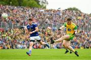 23 June 2019; Patrick McBrearty of Donegal in action against Conor Moynagh of Cavan during the Ulster GAA Football Senior Championship Final match between Donegal and Cavan at St Tiernach's Park in Clones, Monaghan. Photo by Ramsey Cardy/Sportsfile
