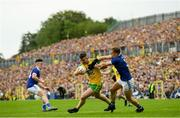 23 June 2019; Patrick McBrearty of Donegal is tackled by Padraig Faulkner of Cavan during the Ulster GAA Football Senior Championship Final match between Donegal and Cavan at St Tiernach's Park in Clones, Monaghan. Photo by Ramsey Cardy/Sportsfile