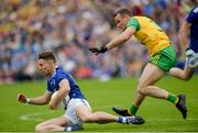 23 June 2019;Thomas Galligan of Cavan of Cavan in action against Neil McGee of Donegal  during the Ulster GAA Football Senior Championship Final match between Donegal and Cavan at St Tiernach's Park in Clones, Monaghan. Photo by Oliver McVeigh/Sportsfile