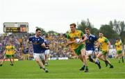 23 June 2019; Hugh McFadden of Donegal in action against Conor Rehill of Cavan during the Ulster GAA Football Senior Championship Final match between Donegal and Cavan at St Tiernach's Park in Clones, Monaghan. Photo by Ramsey Cardy/Sportsfile