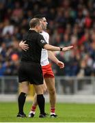22 June 2019; Michael Cassidy of Tyrone with referee Derek O'Mahoney during the GAA Football All-Ireland Senior Championship Round 2 match between Longford and Tyrone at Glennon Brothers Pearse Park in Longford.  Photo by Eóin Noonan/Sportsfile
