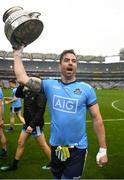 23 June 2019; Dublin's Michael Darragh Macauley with the Delaney Cup after the Leinster GAA Football Senior Championship Final match between Dublin and Meath at Croke Park in Dublin. Photo by Ray McManus/Sportsfile