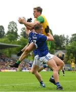 23 June 2019; Hugh McFadden of Donegal in action against Conor Rehill, left, and Padraig Faulkner of Cavan during the Ulster GAA Football Senior Championship Final match between Donegal and Cavan at St Tiernach's Park in Clones, Monaghan. Photo by Ramsey Cardy/Sportsfile