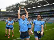 23 June 2019; Dublin's Brian Howard, with Michael Darragh Macauley alongside, with the Delaney Cup after the Leinster GAA Football Senior Championship Final match between Dublin and Meath at Croke Park in Dublin. Photo by Ray McManus/Sportsfile