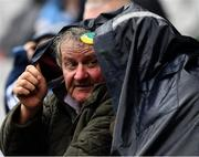 23 June 2019; Meath supporters Matt Grimes, left, from Dundalk, Co Louth and Noel Clarke, from Simonstown GAA Club, Co Meath, take shelter during the Leinster GAA Football Senior Championship Final match between Dublin and Meath at Croke Park in Dublin. Photo by Ray McManus/Sportsfile