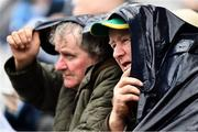 23 June 2019; Meath supporters Matt Grimes, from Dundalk, Co Louth and Noel Clarke, right, from Simonstown GAA Club, Co Meath, take shelter during the Leinster GAA Football Senior Championship Final match between Dublin and Meath at Croke Park in Dublin. Photo by Ray McManus/Sportsfile