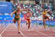 23 June 2019; Sarah Lavin of Ireland, left, crosses the line to finish second in the Women's 100m hurdles during Dynamic New Athletics qualification match three at Dinamo Stadium on Day 3 of the Minsk 2019 2nd European Games in Minsk, Belarus. Photo by Seb Daly/Sportsfile