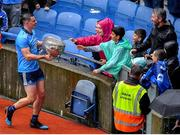 23 June 2019; Brian Howard of Dublin shows the Delaney Cup to supporters after the Leinster GAA Football Senior Championship Final match between Dublin and Meath at Croke Park in Dublin. Photo by Brendan Moran/Sportsfile