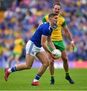 23 June 2019; Killian Clarke of Cavan in action against Michael Murphy of Donegal during the Ulster GAA Football Senior Championship Final match between Donegal and Cavan at St Tiernach's Park in Clones, Monaghan. Photo by Ramsey Cardy/Sportsfile