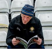 23 June 2019; A general view of a supporter reading the match programme during the Ulster GAA Football Senior Championship Final match between Donegal and Cavan at St Tiernach's Park in Clones, Monaghan. Photo by Oliver McVeigh/Sportsfile