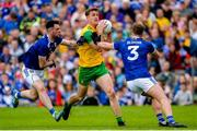 23 June 2019; Hugh McFadden of Donegal in action against Conor Rehill and Padraig Faulkner of Cavan during the Ulster GAA Football Senior Championship Final match between Donegal and Cavan at St Tiernach's Park in Clones, Monaghan. Photo by Oliver McVeigh/Sportsfile