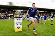 23 June 2019; Killian Clarke of Cavan runs out past the Anglo Celt cup before the Ulster GAA Football Senior Championship Final match between Donegal and Cavan at St Tiernach's Park in Clones, Monaghan. Photo by Oliver McVeigh/Sportsfile