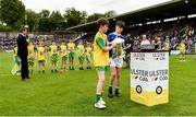 23 June 2019; Matthew Whitmore of Donegal and Darragh Noonan of Cavan bring out the Anglo Celt cup before the Ulster GAA Football Senior Championship Final match between Donegal and Cavan at St Tiernach's Park in Clones, Monaghan. Photo by Oliver McVeigh/Sportsfile