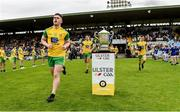 23 June 2019; Patrick McBrearty of Donegal runs out past the Anglo Celt cup before the Ulster GAA Football Senior Championship Final match between Donegal and Cavan at St Tiernach's Park in Clones, Monaghan. Photo by Oliver McVeigh/Sportsfile