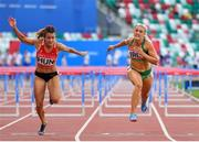 25 June 2019; Sarah Lavin of Ireland, right, crosses the line to finish second behind Greta Kerekes of Hungary in the Women's 100m hurdles during Dynamic New Athletics quarter-final match two at Dinamo Stadium on Day 5 of the Minsk 2019 2nd European Games in Minsk, Belarus.