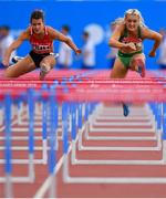25 June 2019; Sarah Lavin of Ireland, right, on her way to finishing second behind Greta Kerekes of Hungary in the Women's 100m hurdles during Dynamic New Athletics quarter-final match two at Dinamo Stadium on Day 5 of the Minsk 2019 2nd European Games in Minsk, Belarus.