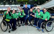 26 June 2019; Martin Donnelly with members of the Irish Wheelchair Hurling team from left Patrick Tobin, Sean Bennet and Lorcan Madden all from Co Laois, Peadar Heffron from Co Antrim, Pat Carthy from Co Sligo and Gary O'Halloran from Co Limerick before the team's departure from Dublin Airport in advance of the ParaGamesBreda 2019 in Breda, Netherlands. Photo by Matt Browne/Sportsfile
