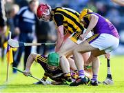 15 June 2019; Matthew O'Hanlon of Wexford gathers possession, supported by team-mate Damien Reck, ahead of Adrian Mullen and TJ Reid, behind, of Kilkenny during the Leinster GAA Hurling Senior Championship Round 5 match between Wexford and Kilkenny at Innovate Wexford Park in Wexford. Photo by Piaras Ó Mídheach/Sportsfile