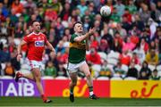 22 June 2019; Tom O'Sullivan of Kerry scores a point with a handpass despit ethe efforts of Paul Kerrigan of Cork during the Munster GAA Football Senior Championship Final match between Cork and Kerry at Páirc Ui Chaoimh in Cork.  Photo by Brendan Moran/Sportsfile