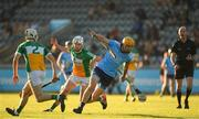 26 June 2019; Diarmaid O Floinn of Dublin is tackled by Joey Keenaghan of Offaly during the Bord Gais Energy Leinster GAA Hurling U20 Championship quarter-final match between Dublin and Offaly at Parnell Park in Dublin. Photo by Eóin Noonan/Sportsfile