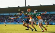 26 June 2019; Sean Currie of Dublin is tackled by Ciaran Burrke of Offaly during the Bord Gais Energy Leinster GAA Hurling U20 Championship quarter-final match between Dublin and Offaly at Parnell Park in Dublin. Photo by Eóin Noonan/Sportsfile