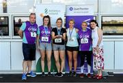 27 June 2019; Orla Cunningham, Rachel Dooley, Tracy O'Connell, and Nicola Gras of Qualtech, who finished 2nd in the Womens Team Race, are presented with their trophy by Aengus Burns of Grant Thornton and Karen Golden from Galway Simon Community after the Grant Thornton Corporate 5K Team Challenge Galway at Ballybrit Racecourse in Galway. Photo by Diarmuid Greene/Sportsfile