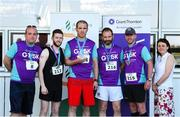 27 June 2019; Alan Flannery, Thomas Scarry, Gordon Nolan and Mark Moran of Penn Engineering, who finished 2nd in the Mens Team Race, are presented with their trophy by Aengus Burns of Grant Thornton and Karen Golden from Galway Simon Community after the Grant Thornton Corporate 5K Team Challenge Galway at Ballybrit Racecourse in Galway. Photo by Diarmuid Greene/Sportsfile