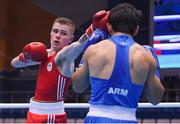 28 June 2019; Regan Buckley, left, of Ireland in action against Artur Hovhannisyan of Armenia during their Men's Light Flyweight semi-final bout at Minsk Arena Velodrome on Day 8 of the Minsk 2019 2nd European Games in Minsk, Belarus. Photo by Seb Daly/Sportsfile