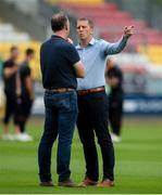 28 June 2019; Dundalk head coach Vinny Perth, right, speaking with Shamrock Rovers Chairman Jonathan Roche ahead of the SSE Airtricity League Premier Division match between Shamrock Rovers and Dundalk at Tallaght Stadium in Dublin. Photo by Eóin Noonan/Sportsfile