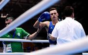 28 June 2019; Michael Nevin of Ireland is prevented from continuing by referee Wade Peterson following a knock-out by Salvatore Cavallaro of Italy during their Men's Middleweight semi-final bout at Minsk Arena Velodrome on Day 8 of the Minsk 2019 2nd European Games in Minsk, Belarus. Photo by Seb Daly/Sportsfile