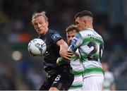 28 June 2019; John Mountney of Dundalk in action against Trevor Clarke of Shamrock Rovers during the SSE Airtricity League Premier Division match between Shamrock Rovers and Dundalk at Tallaght Stadium in Dublin. Photo by Eóin Noonan/Sportsfile