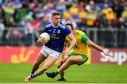 23 June 2019; Killian Clarke of Cavan in action against Michael Murphy of Donegal during the Ulster GAA Football Senior Championship Final match between Donegal and Cavan at St Tiernach's Park in Clones, Monaghan. Photo by Sam Barnes/Sportsfile