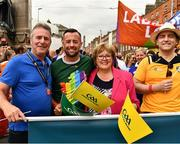 29 June 2019; Inter county GAA referee David Gough, his mother Jacinta and dad Eugene and singer-songwriter and author Brian Kennedy, right, among the GAA group during the Dublin Pride Parade 2019 at O'Connell Street in Dublin. Photo by Ray McManus/Sportsfile