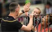29 June 2019; Tyrone goalkeeper Niall Morgan meets 3 year old Tyrone supporter Mena Knox, and Breda Breen ahead of the GAA Football All-Ireland Senior Championship Round 3 match between Kildare and Tyrone at St Conleth's Park in Newbridge, Co. Kildare. Photo by Ramsey Cardy/Sportsfile