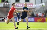 29 June 2019; Peter Kelly of Kildare in action against Brian Kennedy of Tyrone during the GAA Football All-Ireland Senior Championship Round 3 match between Kildare and Tyrone at St Conleth's Park in Newbridge, Co. Kildare. Photo by Ramsey Cardy/Sportsfile