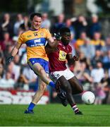 29 June 2019; David Tubridy of Clare shoots to score his side's first goal of the game despite the attentions of Boidu Sayeh of Westmeath during the GAA Football All-Ireland Senior Championship Round 3 match between Westmeath and Clare at TEG Cusack Park in Mullingar, Westmeath. Photo by Sam Barnes/Sportsfile