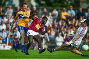 29 June 2019; David Tubridy of Clare shoots to score his side's first goal of the game despite the attentions of Boidu Sayeh, left, and Eoin Carberry of Westmeath during the GAA Football All-Ireland Senior Championship Round 3 match between Westmeath and Clare at TEG Cusack Park in Mullingar, Westmeath. Photo by Sam Barnes/Sportsfile