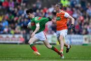 29 June 2019; Conor Loftus of Mayo is tackled by Mark Shields of Armagh during the GAA Football All-Ireland Senior Championship Round 3 match between Mayo and Armagh at Elverys MacHale Park in Castlebar, Mayo. Photo by Brendan Moran/Sportsfile