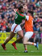 29 June 2019; Aidan O'Shea of Mayo is tackled by Aidan Nugent of Armagh during the GAA Football All-Ireland Senior Championship Round 3 match between Mayo and Armagh at Elverys MacHale Park in Castlebar, Mayo. Photo by Brendan Moran/Sportsfile