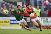 29 June 2019; Jamie Clarke of Armagh in action against Chris Barrett of Mayo during the GAA Football All-Ireland Senior Championship Round 3 match between Mayo and Armagh at Elverys MacHale Park in Castlebar, Mayo. Photo by Ben McShane/Sportsfile